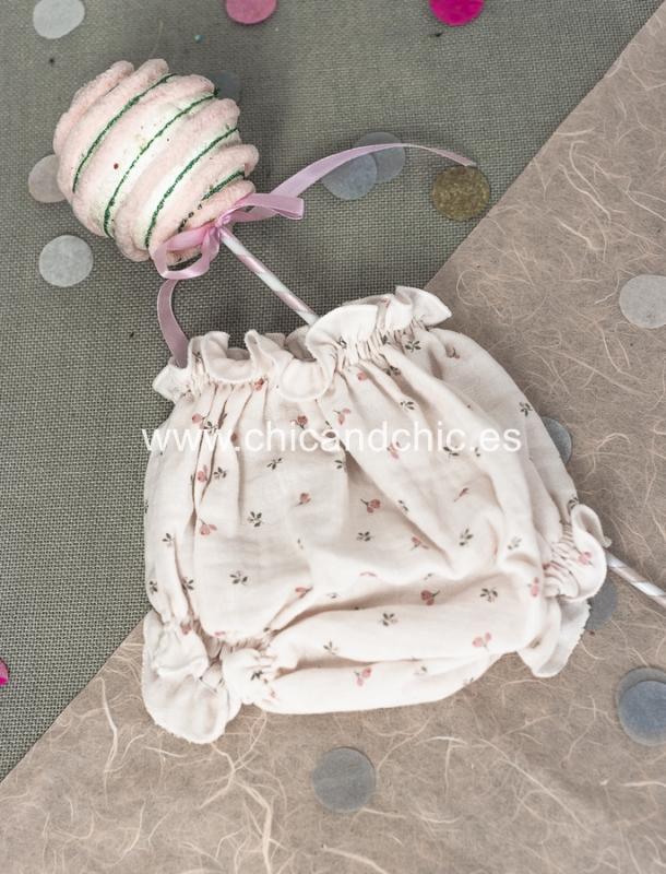 Braga cubrepañal algodón. Estampados en rosa.