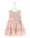 Vestido de ceremonia en crep, con falda de capas. Color rosa